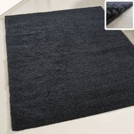 zwart hoogpolig vloerkleed